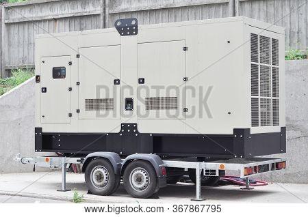 Industrial Generator Power. Mobile Diesel Backup Generator On Caravan Wheels.  Backup Power Supply G