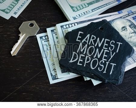 Earnest Money Deposit Label And Stack Of Money.