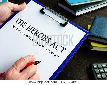 Man Reads Heroes Act Or Health And Economic Recovery Omnibus Emergency Solutions Act.