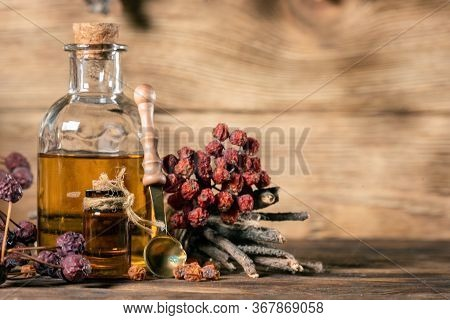 Bottle Of Magic Potion On The Witch Doctor Table Close Up.