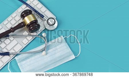 Shot Brown Gavel, Medical Stethoscope And Mask, Computer Keyboard. Technology Concept In Medicine On