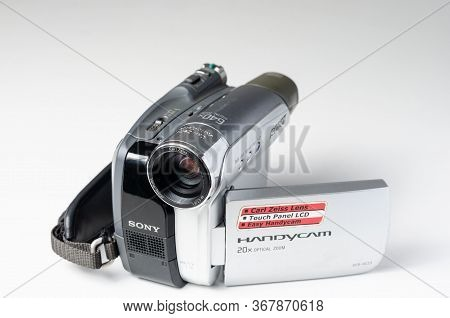 Romania -may 08,2020  : Close-up Of Used Old  Storage  Sony Camcorder  , Handycam On White  Backgrou