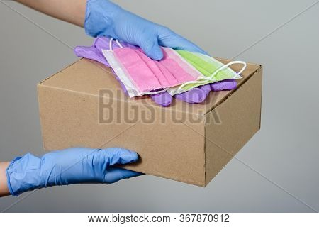Hands With  Surgical Gloves  Of A Woman Or Man Holding   Gift Boxes  Package  ,  Surgical Gloves   A