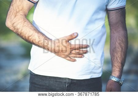 Young Man Shows That His Stomach Hurts