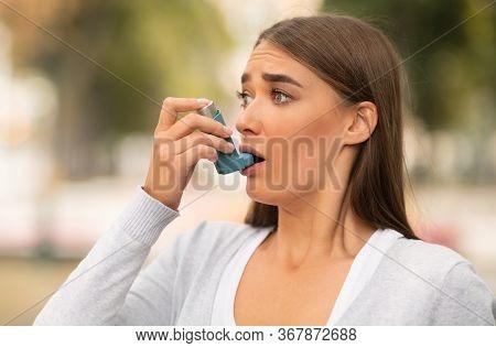 Asthma Disease. Woman Having Asthmatic Attack Using Inhaler Preventing Respiratory Depression Standi