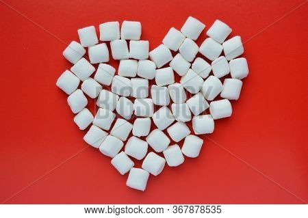 Marshmallows On Red Background With Copyspace. Flat Lay Or Top View. Background Or Texture Of Colorf