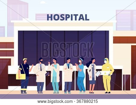 Medical Team. Hospital Building, Professional Nurse And Doctors. Health Specialist Staff In Uniform.