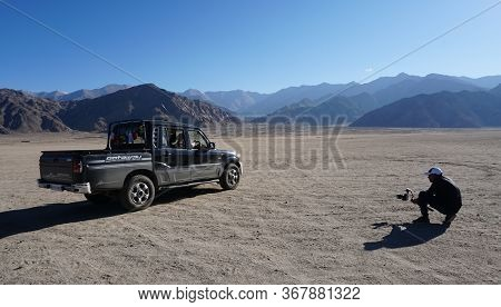 Man Clicking Picture Of A 4x4 Jeep Exterior In Leh Ladakh City, Jammu & Kashmir State, India - Septe