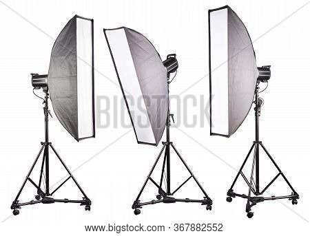 Photo Studio Lighting Stands With Flash And Softbox Isolated On The White.