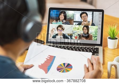 Rear View Of Asian Business Man Presenting The Data Graph Analyze With Teamwork Colleague In Video C