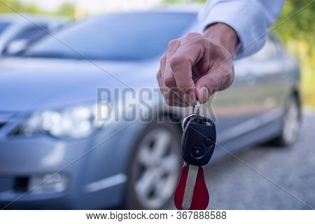 The Owner Or Sales Representative Is Sending The Rental Car Keys To The Buyer Or The Renter. Concept