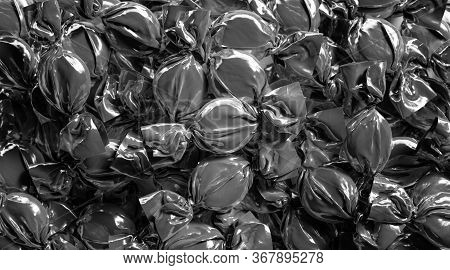 Blank Black Hard Candy Foil Wrapper Mock Up Stack, 3d Rendering. Empty Confection Or Bonbon Swirl Pa