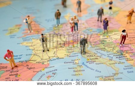 Many Figures Of People Are Placed On Europe Map. Open Borders Concept.