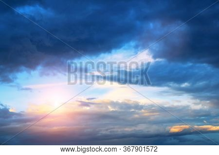 Sunset sky background. Sunset clouds lit by evening soft sunlight. Vast sky landscape panoramic scene - colorful sunset sky view. Sky sunset background, sky sunny scene. Sunset sky landscape view