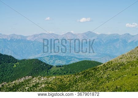 Scenic Aerial View To Green Forest Hills And Long Mountain Range Under Blue Sky. Awesome Minimalist