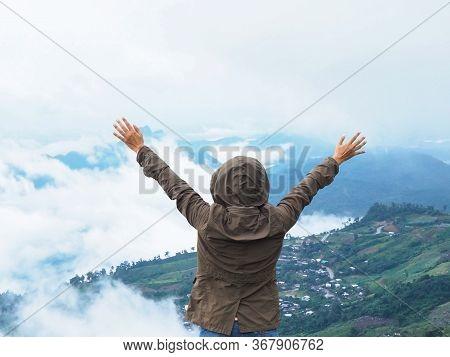 Back View Happy Woman Tourist Raise Arm At View Point Of  Phu Thap Berk High Mountain In Phetchabun