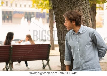 Man Spying On Girls Stalking Them While They Talking Sitting In Park