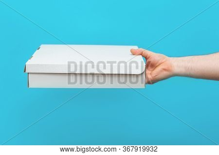 A Man Holds Boxes In His Hands. Service Delivery Of Goods. City Delivery Service. Post Delivery.