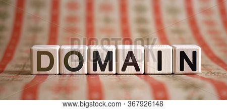 Domain - Text Concept On Wooden Cubes On A Striped Bright Background