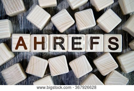 Ahrefs - Text Concept Seo On A Wooden Background Surrounded By Cubes