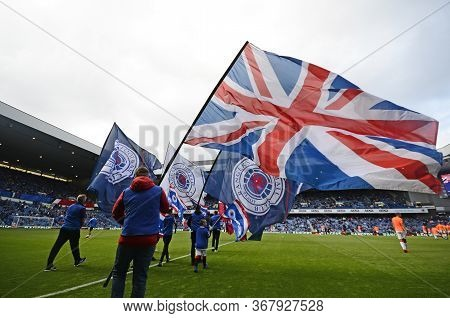 Glasgow, Scotland - July 18, 2019: Union Jack And Rangers Flags Pictured Prior To The 2nd Leg Of The