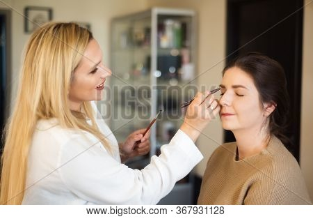 Make Up Artist Beautician Work In Her Beauty Visage Studio Salon Making Make-up For Model. Woman App
