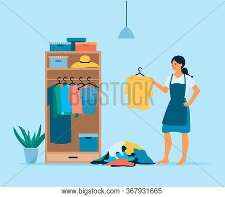 Vector Flat Girl Organize Her Wardrobe. Clothes Hanging Inside Closet. Pile Of Useless Clothes On Fl