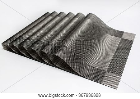 Gray placemats arranged on a white background.