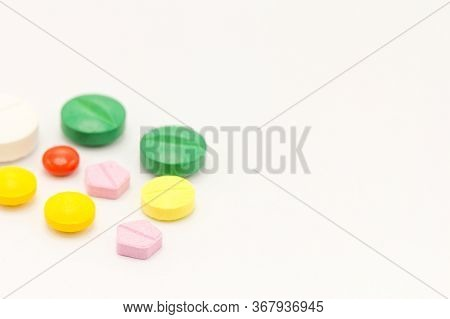 Close Up Different Kind Of Medicines.on White Background