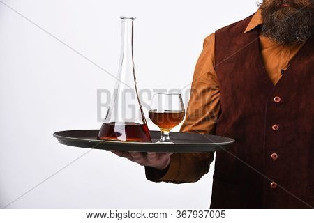 Barman In Vintage Suede Leather Waistcoat Serves Scotch Or Brandy.
