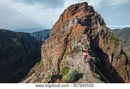 Female Backpacker Walking By Famous Mountain Footpath From Pico Do Arieiro To Pico Ruivo With Breath