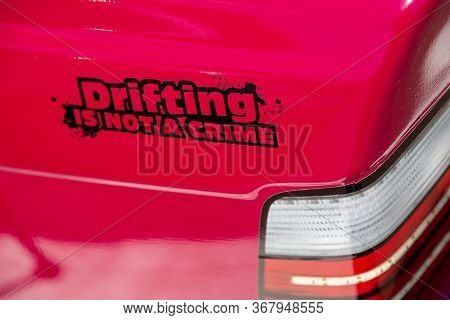 Sticker With The Inscription Drifting Is Not A Crime On The Red Body Of A Sports Drift Car Near The