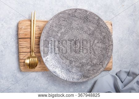 Empty Black Slate Plate On Grey Stone Table And Napkin. Food Background For Menu, Recipe. Table Sett