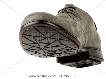 View On Sole Of Single Male Chamois Leather Boot  Isolated On White Background