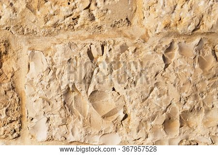 Wall Sandstone Texture Background. Yellow Old Grunge Surface, Stone Vintage Texture. Voluminous Back