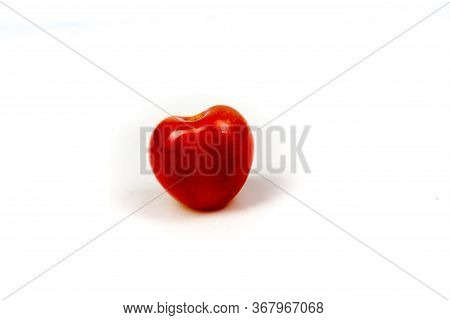One Fresh Ripe Cheery Berry In Closeup On Isolated White Background. Berries