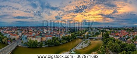 Dramatic Sky At Sunrise Over Munich As Panoramic Aerial With A Wonderful Wide View Over The Bavarian