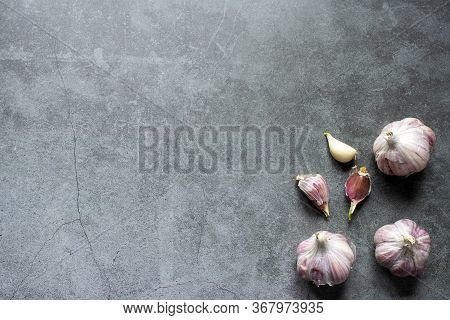 Garlic, Onions And Beans On A Dark Background. Still Life With Onions Of Garlic And Onions. Top View