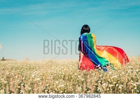 Woman With Lgbt Flag On The Field