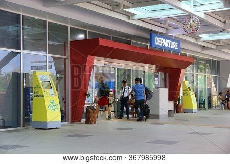 Puerto Princesa, Philippines - December 6, 2017: People Enter Puerto Princesa Airport, Palawan Islan