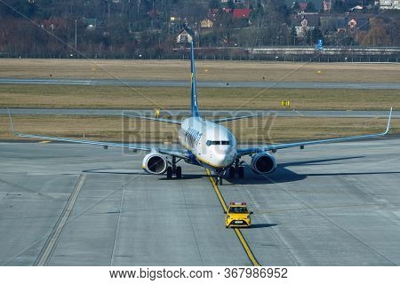 Ryanair Boeing 737-800 Is At The Airport, Preparing For Flight. The Service Of The Vessel Flying Bef