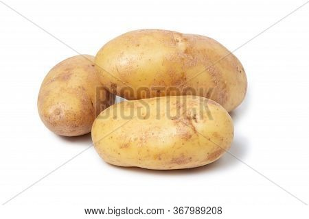Several Potato Tubers On A White Isolated Background. Fresh Vegetables. Yellow Potatoes.