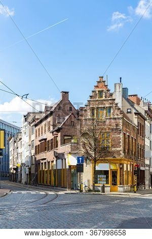 Cityscape of Meir shopping street road in Antwerp downtown in Belgium with tram track. EU Begium city landmark and shopping center for tourism and travel destination concept.