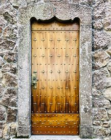 Old Door Of A Castle In Wooden Wall With Metal Ornaments Vertical Shot