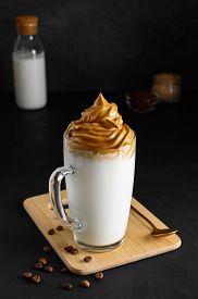 Iced Dalgona Coffee In Glass Mug On Dark Background. Trendy Refreshment Creamy Whipped Coffee. Korea