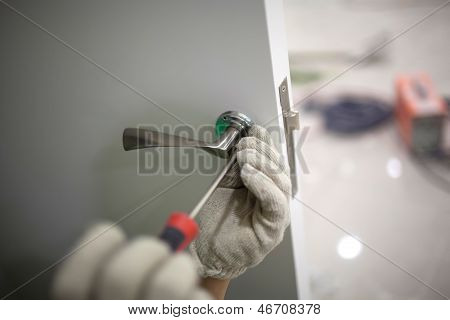Workers Installing Locks