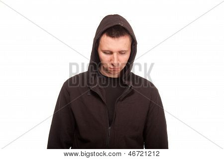 Young man in a hoodie looking down