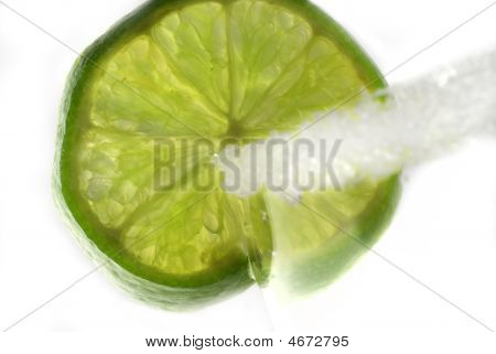 Slice Of Lime On The Rim Of A Glass.