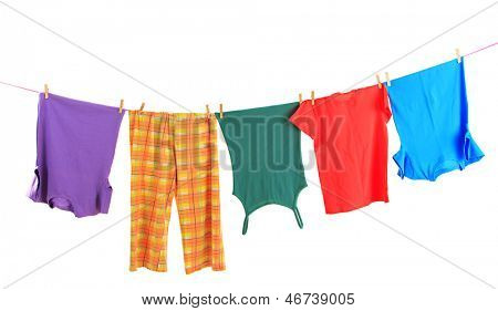 Laundry line with clothes isolated on white