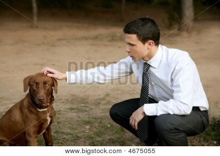 Businessman with brown dog outdoor in autumn park poster